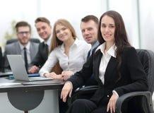Femme d'affaires et équipe d'affaires Image libre de droits