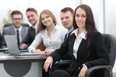 Femme d'affaires et équipe d'affaires Photo stock