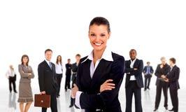 Femme d'affaires et équipe de shis Photographie stock libre de droits