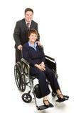 Femme d'affaires et collègue handicapés Photographie stock libre de droits