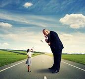 Femme d'affaires et homme d'affaires fâchés Image stock