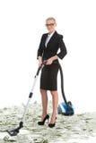 Femme d'affaires féminine attirante avec l'aspirateur Photographie stock libre de droits