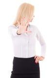 Femme d'affaires faisant le signe d'arrêt d'isolement sur le fond blanc Image stock