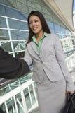 Femme d'affaires Greeting Male Colleague Photographie stock libre de droits