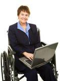 Femme d'affaires handicapée amicale Photographie stock libre de droits