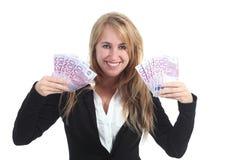 Femme d'affaires heureuse avec beaucoup d'argent Images stock