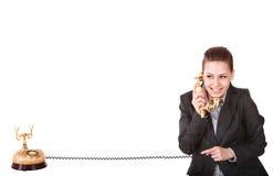 Femme d'affaires heureuse avec le téléphone d'or. Images stock