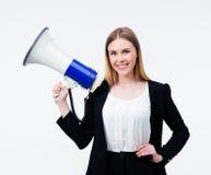 Femme d'affaires heureuse tenant le mégaphone Images stock