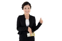Femme d'affaires jugeant une loupe d'isolement sur le fond blanc images stock