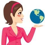 Femme d'affaires latérale Holding World Photo libre de droits