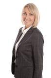 Femme d'affaires mûre réussie d'isolement au-dessus du fond blanc Photo stock