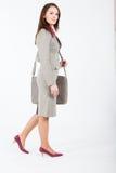 Femme d'affaires marchant avec le cas Photos libres de droits