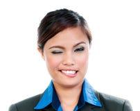 Femme d'affaires mignonne Winking Photo stock