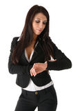 Femme d'affaires observant l'horloge Images libres de droits