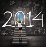Femme d'affaires obtenant le succès pendant la nouvelle année 2014 Photographie stock