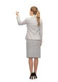 Femme d'affaires ou professeur avec le marqueur du dos photos stock