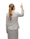 Femme d'affaires ou professeur dans le costume du dos Photos libres de droits
