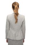 Femme d'affaires ou professeur dans le costume du dos Photos stock
