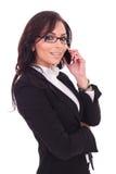 Femme d'affaires parlant au téléphone Photo stock