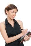 Femme d'affaires pensant, écrivant Photo stock