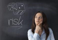 Femme d'affaires pensant à prendre des risques Images libres de droits