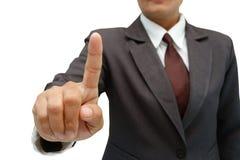 Femme d'affaires poussant sur un écran tactile Images stock