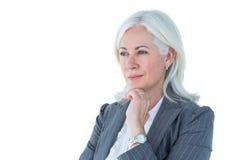 Femme d'affaires réfléchie touchant son menton images stock