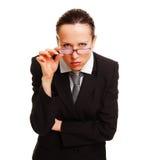 femme d'affaires regardant la poupe fixement Images stock