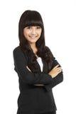 Femme d'affaires restant avec la main pliée photo stock