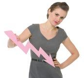 Femme d'affaires retenant la flèche décroissante de diagramme Photos libres de droits