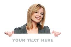 Femme d'affaires retenant le signe blanc Photo stock