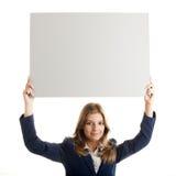 Femme d'affaires retenant un panneau-réclame Photos stock