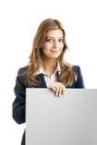 Femme d'affaires retenant un panneau-réclame Image libre de droits