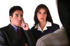 Femme d'affaires s'occupant de deux clients Image libre de droits