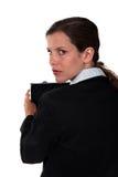 Femme d'affaires se comportant étrangement Image libre de droits