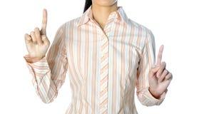 Femme d'affaires se dirigeant à quelque chose d'isolement sur le backgroun blanc Images stock