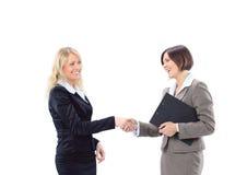 Femme d'affaires se serrant la main saluant Image stock
