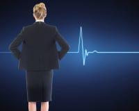 Femme d'affaires se tenant avec des mains sur des hanches Photos stock