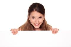 Femme d'affaires - signe blanc de fixation Image stock