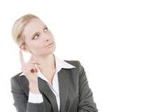 Femme d'affaires songeuse photo stock