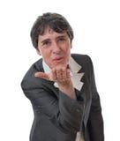 Femme d'affaires soufflant un baiser Photo stock
