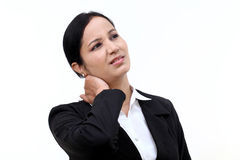Femme d'affaires souffrant de la douleur cervicale images stock