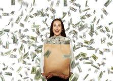Femme d'affaires sous la pluie du dollar Photos libres de droits