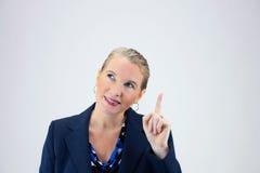 Femme d'affaires supportant un doigt Photos libres de droits