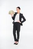 Femme d'affaires tenant des billets de banque du dollar Photographie stock libre de droits