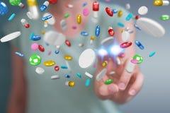 Femme d'affaires tenant et touchant les pilules de flottement 3D de médecine au sujet de Images libres de droits