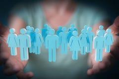 Femme d'affaires tenant et touchant 3D rendant le groupe de pe bleu Photographie stock