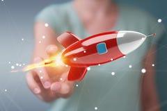 Femme d'affaires tenant et touchant un rendu de la fusée 3D Photo stock