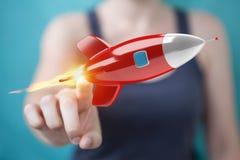 Femme d'affaires tenant et touchant un rendu de la fusée 3D Images stock