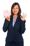 Femme d'affaires tenant l'argent-boîte de porc photo libre de droits